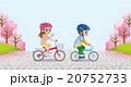 サイクリングする子供 ヘルメット着用 桜の木背景 20752733