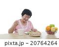 asian senior female dining 20764264