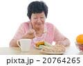 asian senior female dining 20764265
