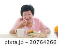 asian senior female dining 20764266