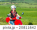 Young woman traveling by a scooter 20811642