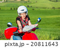 Young woman traveling by a scooter 20811643