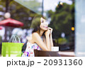 smiling young woman thinking in cafe shop 20931360