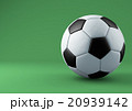 Soccer ball with shadows on green background. 20939142