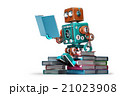 Retro robot reading a book. Isolated 21023908