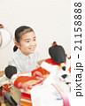 お雛様と女の子 お雛様 子供 女の子 小学生 桃の節句 ひな祭り 21158888