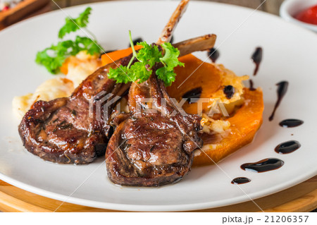 Roasted lamb ribs with  grilled pumpkin 21206357