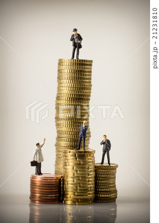 Business people and euro coin pilesの写真素材 [21231810] - PIXTA