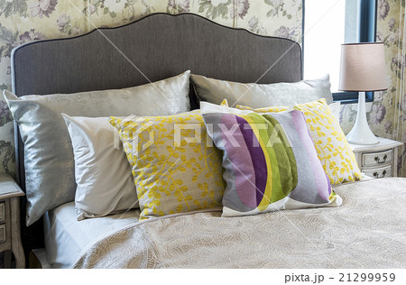 Colorful pillow on bed 21299959
