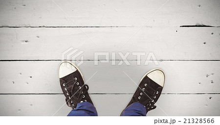 Composite image of man standing on hardwood floorの写真素材 [21328566] - PIXTA