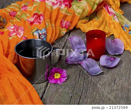 the candle, mug and orange scarf lilac petalsの写真素材 [21372569] - PIXTA