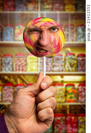 Man's face in lollipopの写真素材 [21411553] - PIXTA
