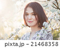 Beautiful young woman in blooming sakura 21468358