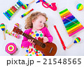 Little girl with music instruments 21548565
