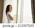 Portrait of a beautiful woman staying near the 21597505