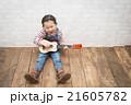 ギターを弾く女の子 21605782