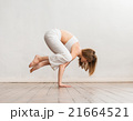 Young and sporty girl training. Yoga exercise. 21664521