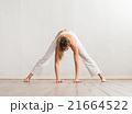 Young and sporty girl training. Yoga exercise. 21664522