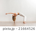Young and sporty girl training. Yoga exercise. 21664526