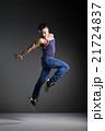 Dancer posing in front of the studio background 21724837