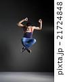 Dancer posing in front of the studio background 21724848