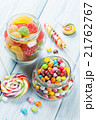 Colorful candies on wooden table 21762767