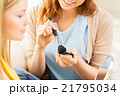 happy women with makeup brush applying blush 21795034