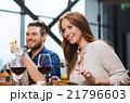 happy couple having dinner at restaurant 21796603