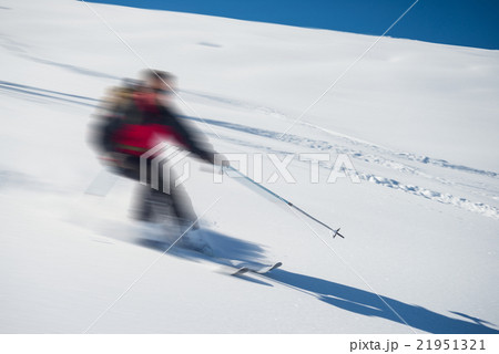 Freeriding on fresh powder snow, blurred motion 21951321