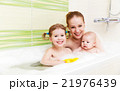 bathing in  bath with foam mother together children baby 21976439