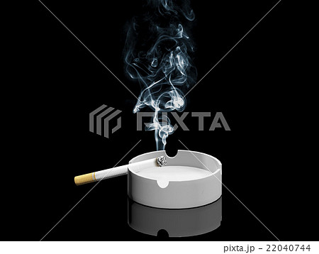 Cigarette and smoke on ashtray isolated  22040744