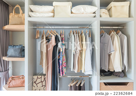 white wardobe and dressing table with clothes の写真素材 22362684