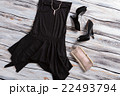 Black sleeveless dress with shoes. 22493794