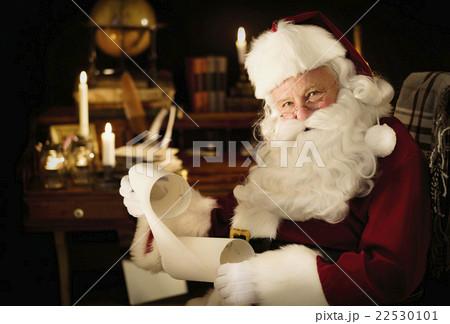 Portrait of Santa Claus reading child's letter 22530101