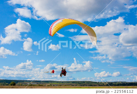 paraglider in blue sky sunny day 22556112