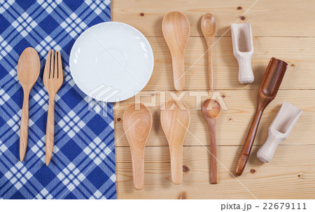 Wooden kitchen utensil on tablecloth backgroundの写真素材 [22679111] - PIXTA