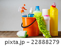 Bucket with cleaning items on light background 22888279