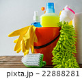 Bucket with cleaning items on light background 22888281