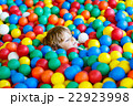 child playing at colorful plastic balls playground 22923998