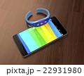 木目の机にあるスマートフォンとスマートバンド 22931980