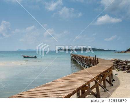 Old wooden Bridge to the blue sea 22958670