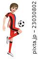 ユニホームを着た少年がサッカーボールを蹴っている。 23030802