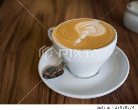 Coffee cup on a wooden table 23089574