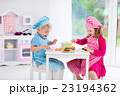 Kids playing with toy kitchen 23194362
