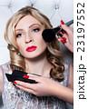 Makeup artist applying blusher 23197552