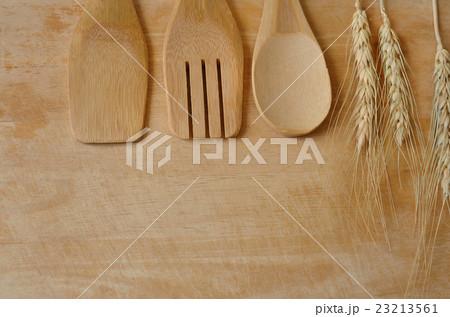 Wooden kitchen utensils on wooden background 23213561