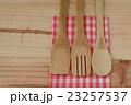 Wooden kitchen utensils on wooden background 23257537