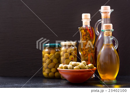 bottles of olive oil and preserved olivesの写真素材 [23402100] - PIXTA