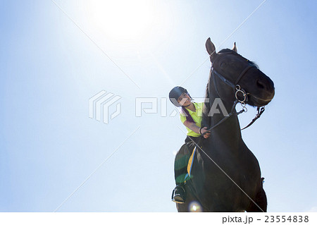 Beautiful teen girl on the farm with her horse.の写真素材 [23554838] - PIXTA
