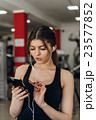 Beautiful girl with a phone in the gym 23577852
